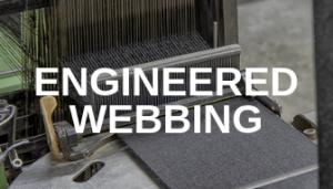 Webbing being sewn with Engineered Webbing printed on top.