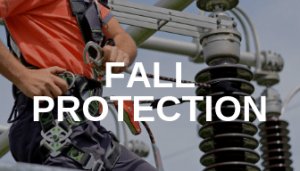 Man clipping a harness with Fall Protection written on top.